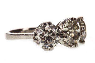 Lot 9-AN IMPRESSIVE DIAMOND THREE STONE RING