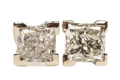 Lot 67-A PAIR OF DIAMOND STUD EARRINGS
