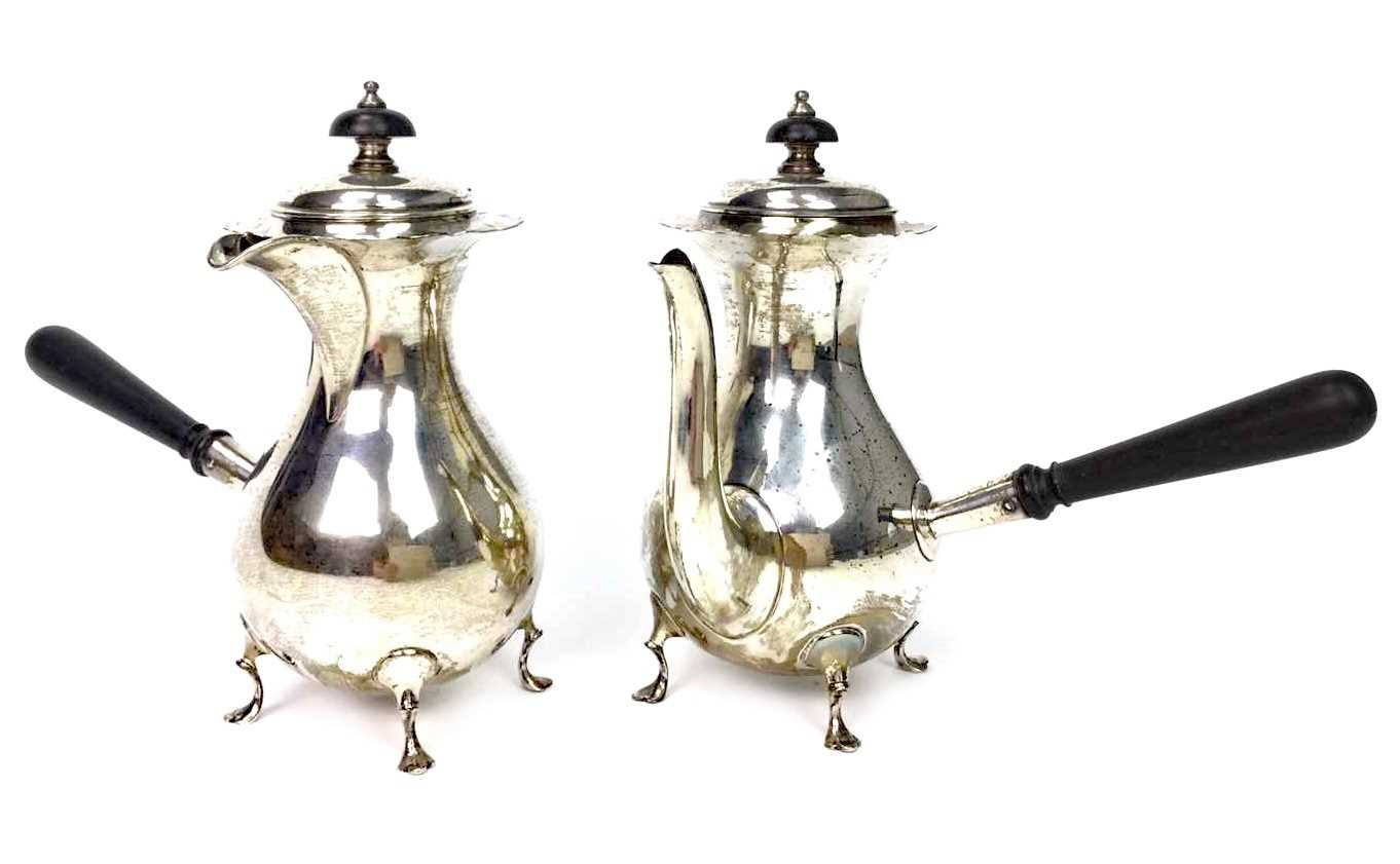 Lot 828 - A SILVER COFFEE POT AND WATER JUG