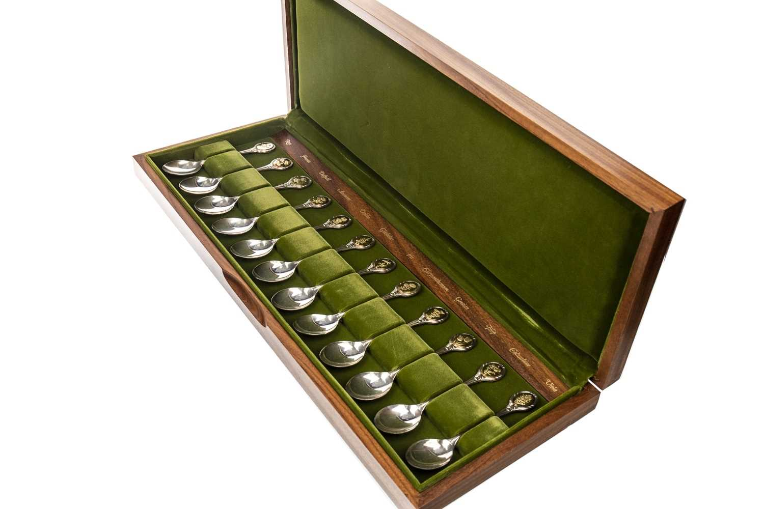 Lot 835 - A SET OF TWELVE ROYAL HORTICULTURAL SOCIETY SILVER SPOONS