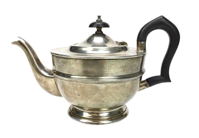 Lot 816 - A GEORGE V SILVER TEA POT