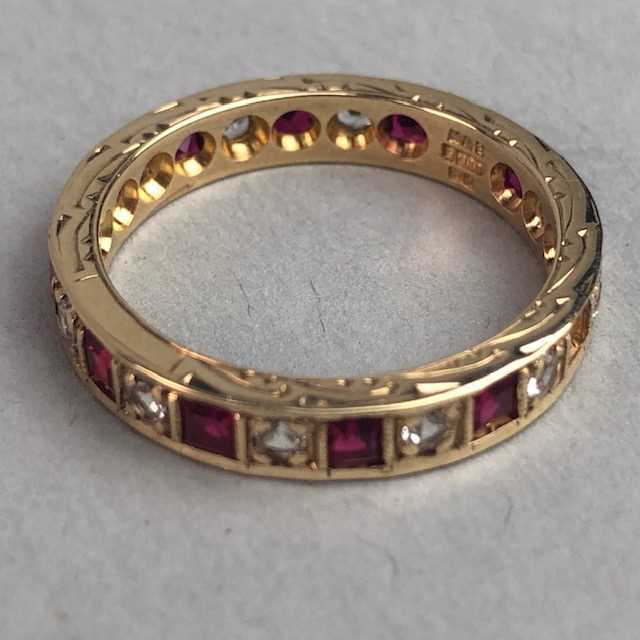 Lot 304-RED AND WHITE GEM SET RING