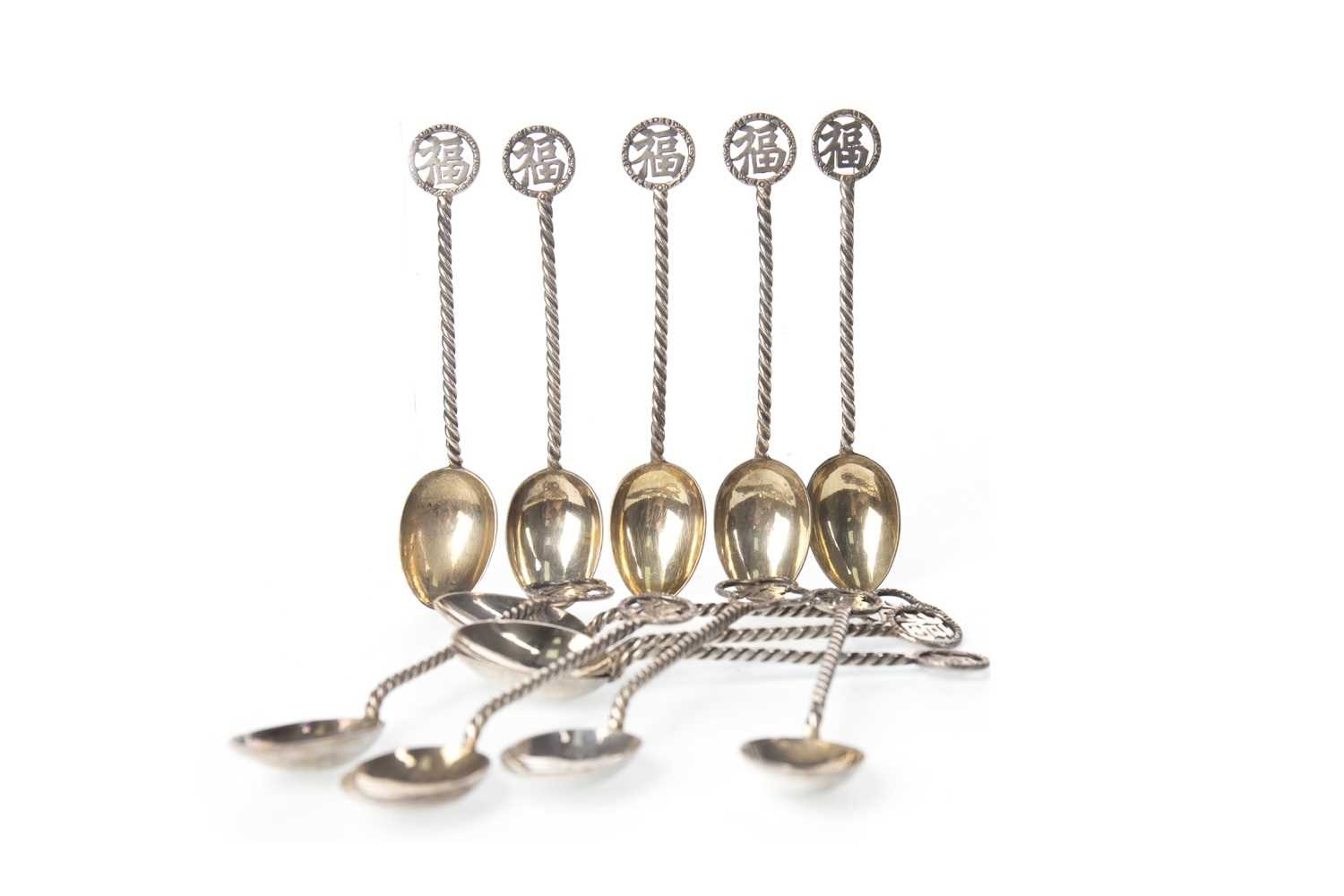 Lot 1016-A SET OF TWELVE EARLY 20TH CENTURY CHINESE SILVER TEA SPOONS