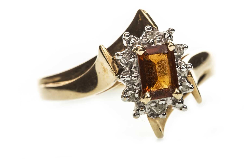 Lot 229-AN ORANGE GEM  AND DIAMOND RING