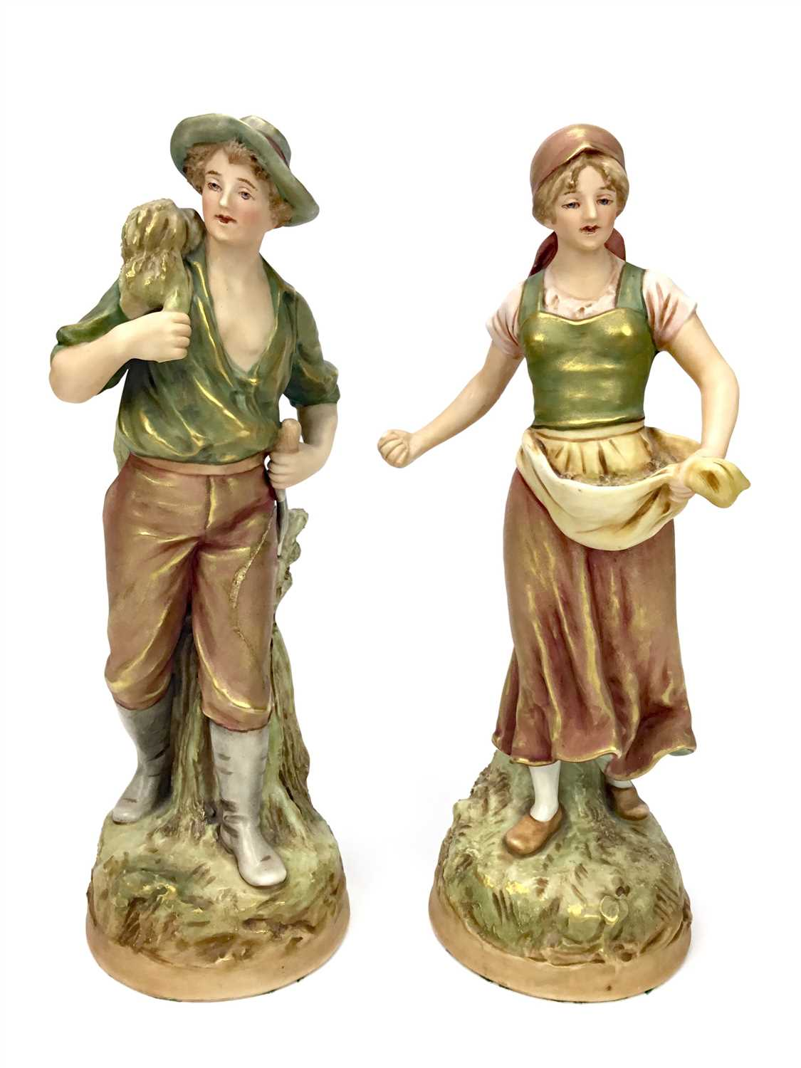 Lot 1230-A PAIR OF ROYAL DUX FIGURES OF YOUNG FARMHANDS