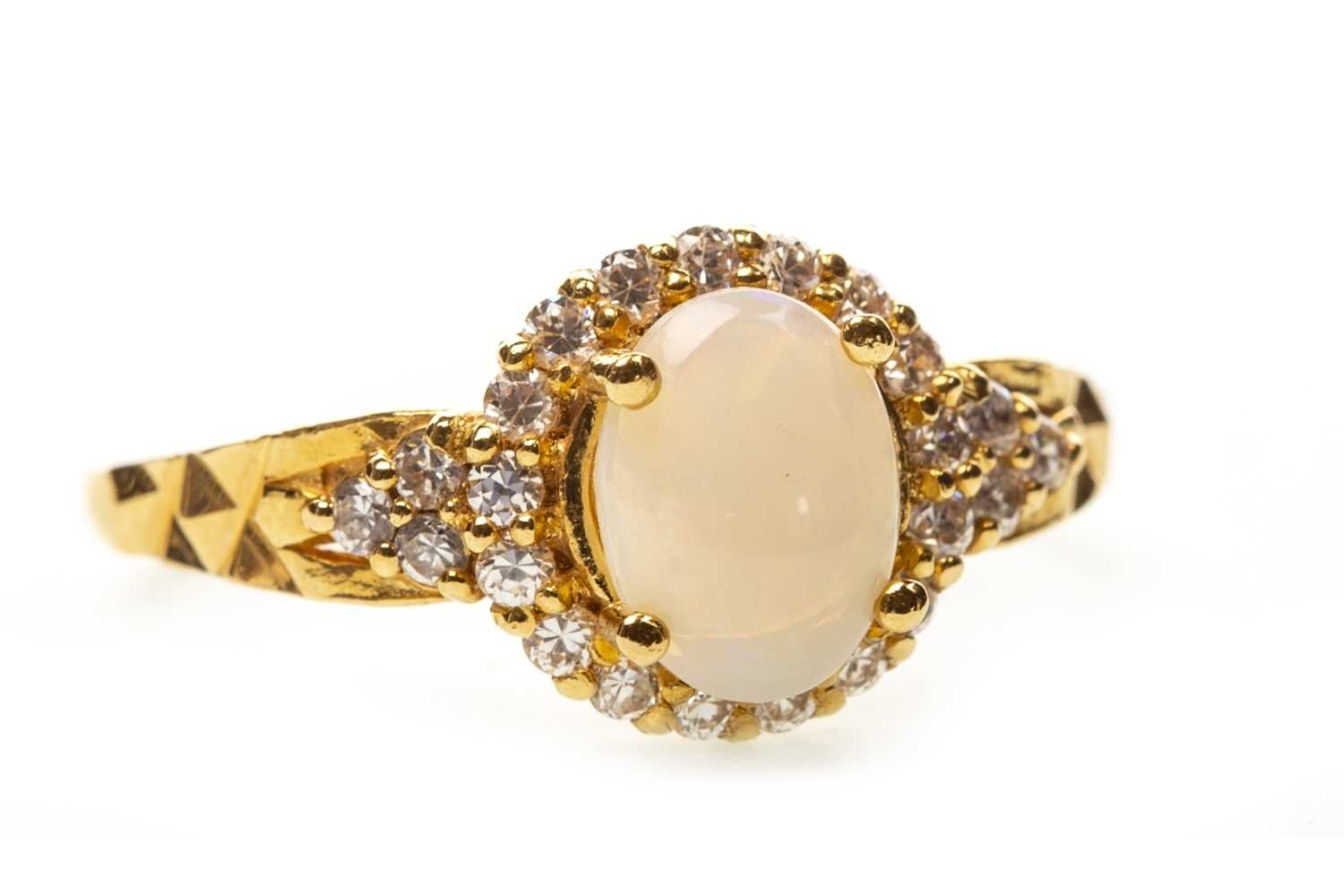 Lot 8-AN OPAL AND GEM SET RING