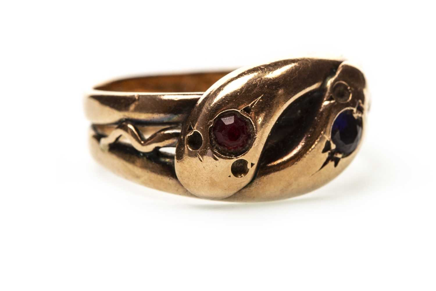 Lot 21-A VICTORIAN GOLD GEM SET SERPENT RING