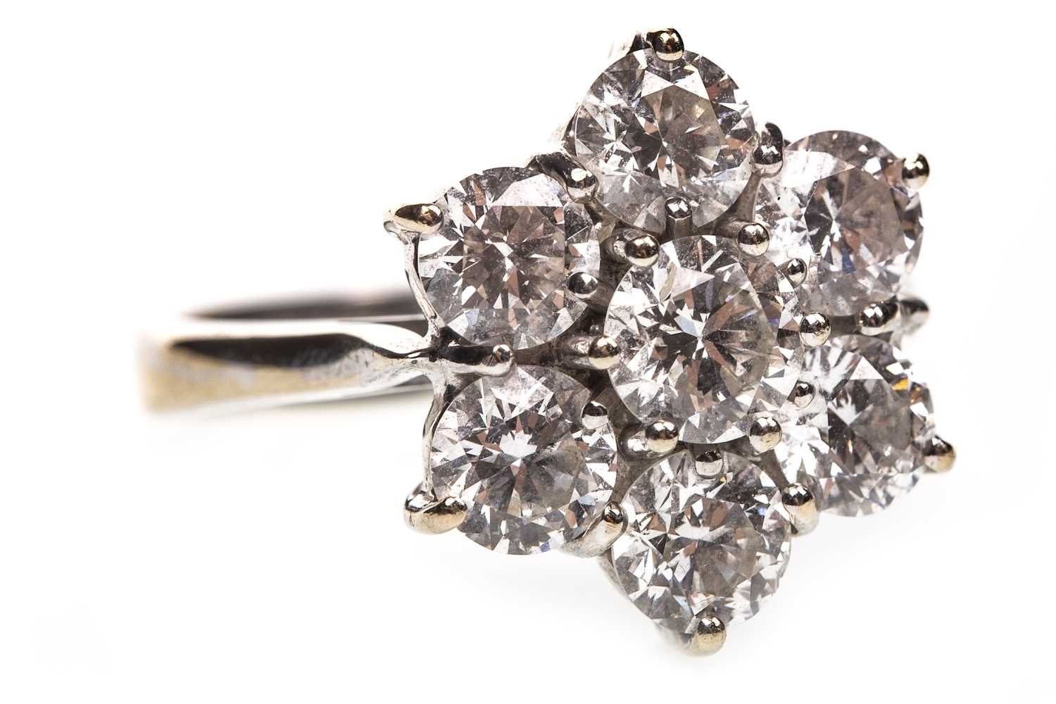 Lot 1-A DIAMOND FLORAL CLUSTER RING