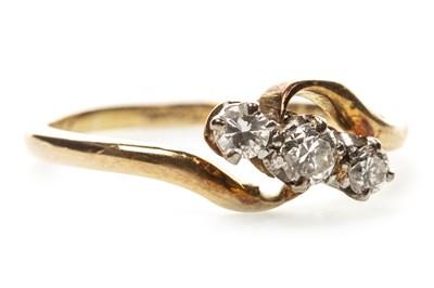 Lot 28-A DIAMOND THREE STONE RING