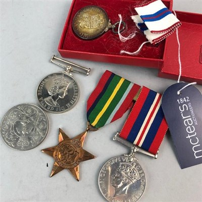 Lot 25-AN EXEMPLARY POLICE SERVICE MEDAL AND OTHER MEDALS