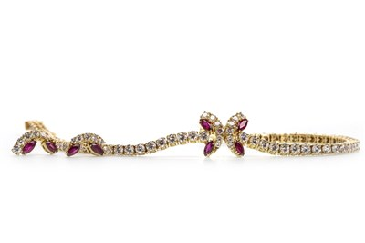 Lot 100-A RUBY AND DIAMOND BRACELET AND MATCHING EARRINGS