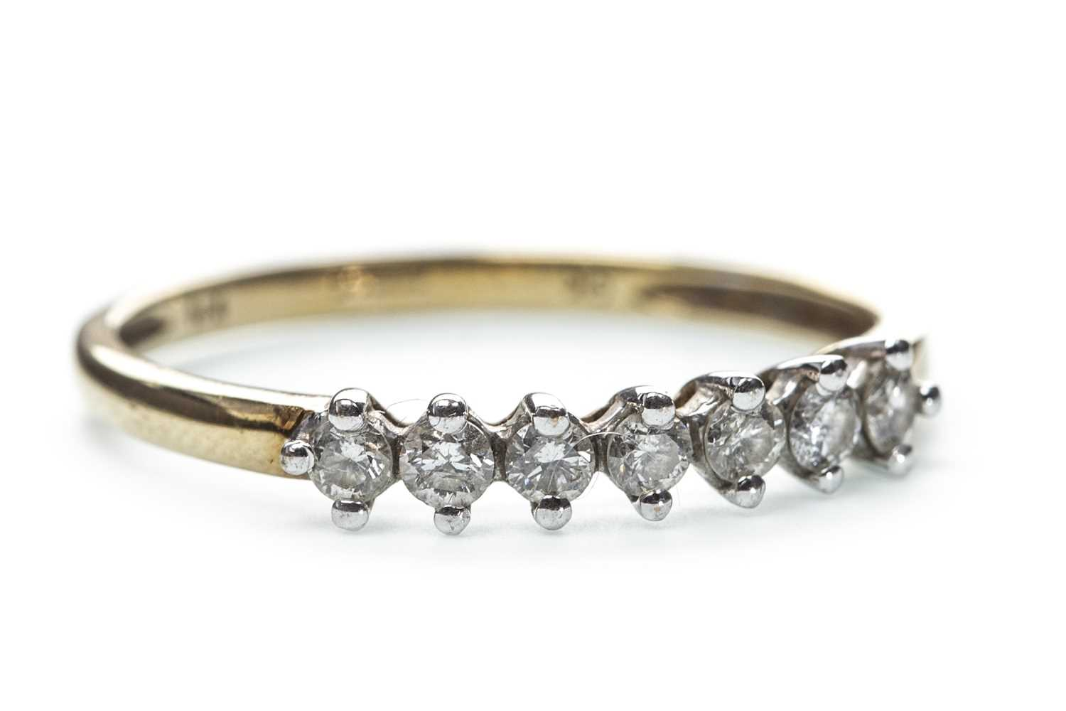 Lot 141-A DIAMOND SEVEN STONE RING