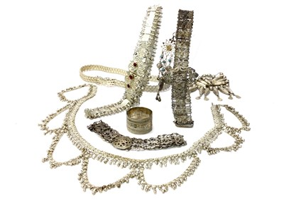 Lot 1056-A COLLECTION OF EASTERN WHITE METAL BELTS AND CHAINS