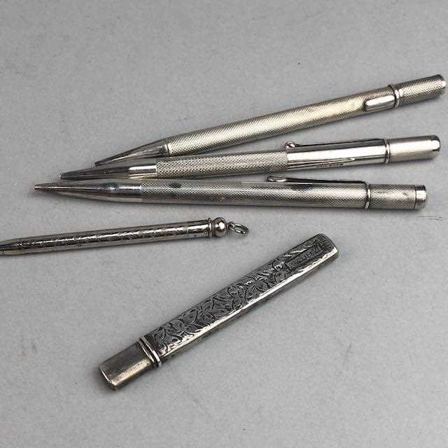 Lot 17-THREE SILVER PROPELLING PENCILS AND TWO OTHERS