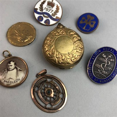 Lot 44-A GROUP OF FOBS, BADGES AND A COIN HOLDER