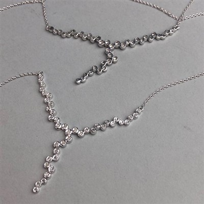 Lot 50-TWO SILVER NECKLETS