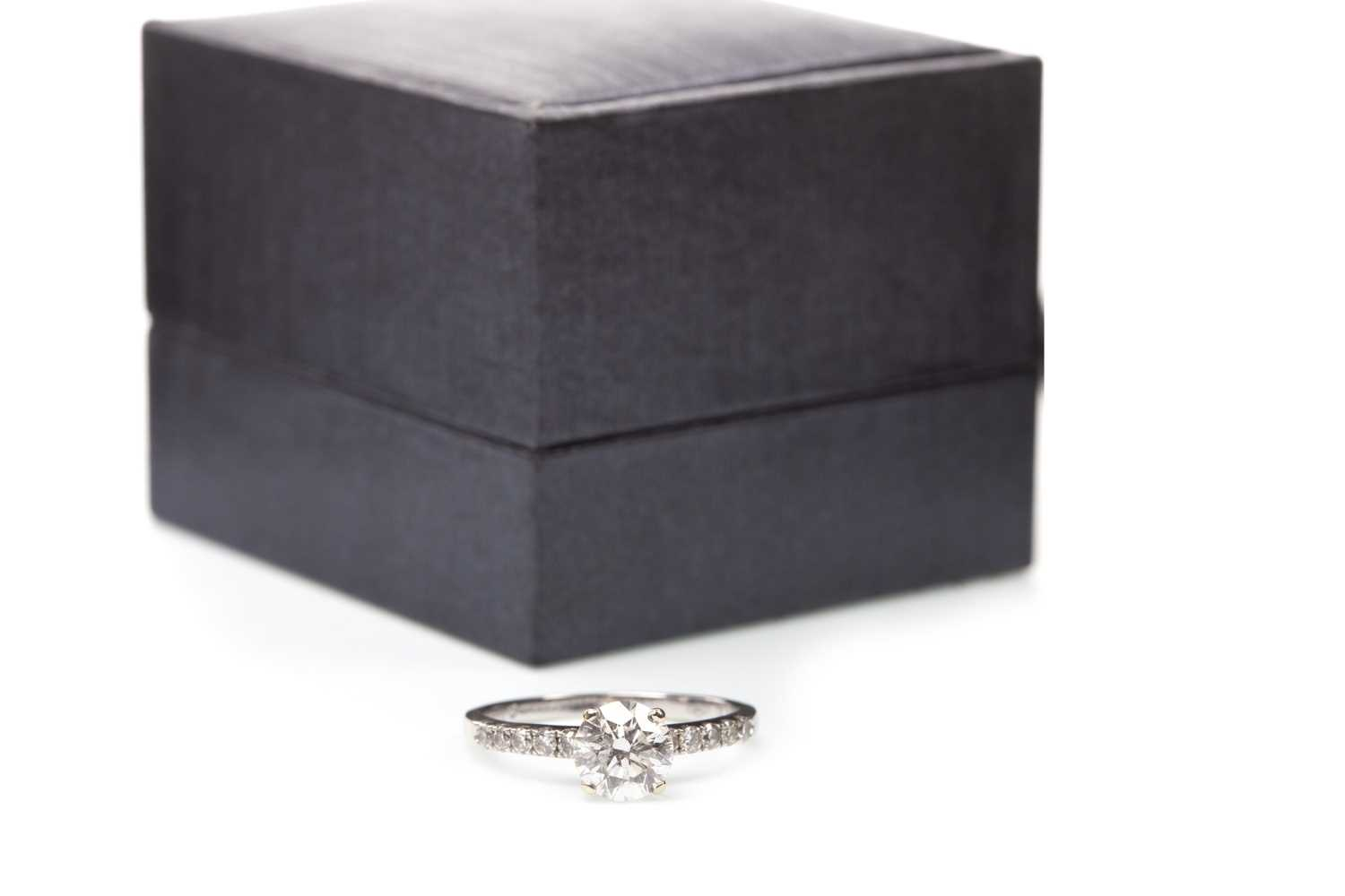 Lot 100-A DIAMOND SOLITAIRE RING