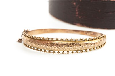 Lot 12-A NINE CARAT GOLD BANGLE WITH CHARM AND RING