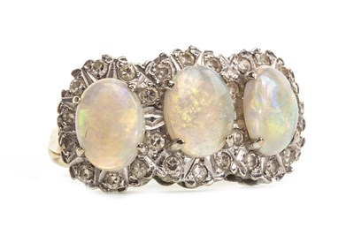 Lot 27-AN OPAL AND DIAMOND RING