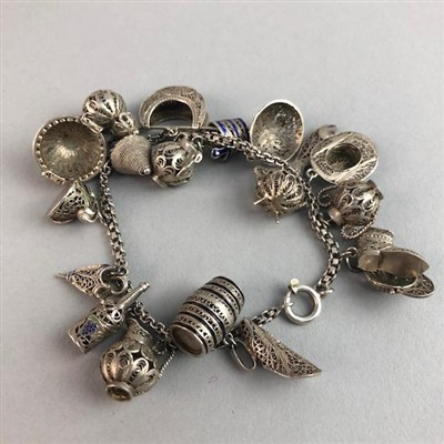 Lot 15-A PORTUGUESE FILIGREE CHARM BRACELET AND TWO OTHER BRACELETS