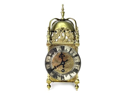 Lot 1424-AN EARLY 20TH CENTURY BRASS LANTERN CLOCK