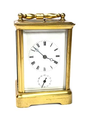 Lot 1433-AN EARLY 20TH CENTURY BRASS REPEATER CARRIAGE CLOCK