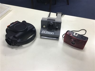 Lot 21-A LOT OF FURS AND CAMERAS