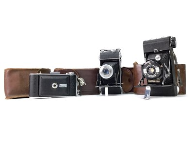 Lot 1485-AN AGFA BILLY RECORD BELLOWS ACTION FOLDING CAMERA AND SIX OTHER FOLDING CAMERAS