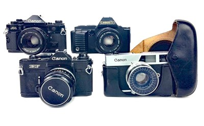 Lot 1490-A LOT OF FOUR CANON CAMERAS INCLUDING A CANON A-1 SLR