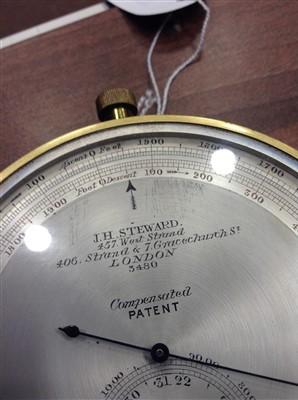 Lot 1443-A BRASS CASED ANEROID ALTIMETER BY J. H. STEWARD