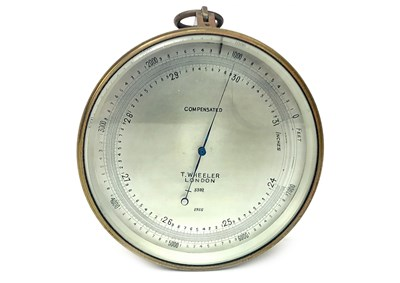 Lot 1444-A BRASS CASED ANEROID BAROMETER BY T. WHEELER