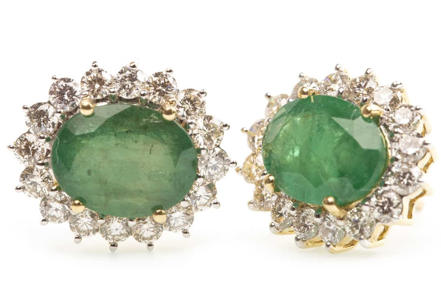 Lot 20-A PAIR OF EMERALD AND DIAMOND CLUSTER EARRINGS