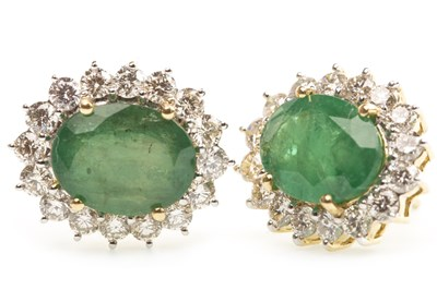 Lot 20A-A PAIR OF EMERALD AND DIAMOND CLUSTER EARRINGS
