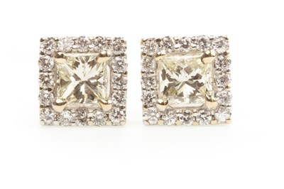 Lot 40-A PAIR OF DIAMOND EARRINGS