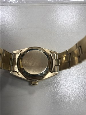 Lot 755-A LADY'S ROLEX DATEJUST GOLD WATCH