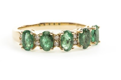 Lot 90-AN EMERALD AND DIAMOND RING