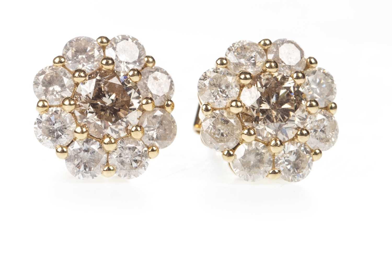 Lot 35-A PAIR OF DIAMOND CLUSTER EARRINGS