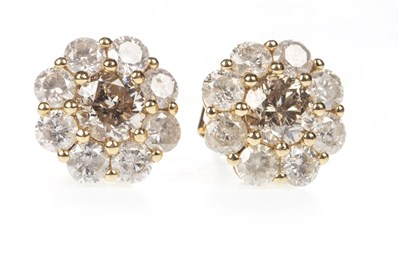 Lot 35-A PAIR OF DIAMOND CLUSTER EARRINGS