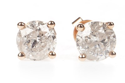 Lot 50-A PAIR OF DIAMOND STUD EARRINGS