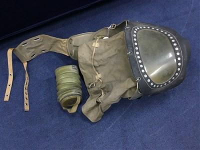 Lot 57 - A WWII BABY'S GAS MASK
