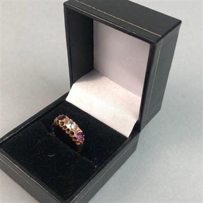 Lot 64 - A NINE CARAT GOLD GARNET AND DIAMOND DRESS RING