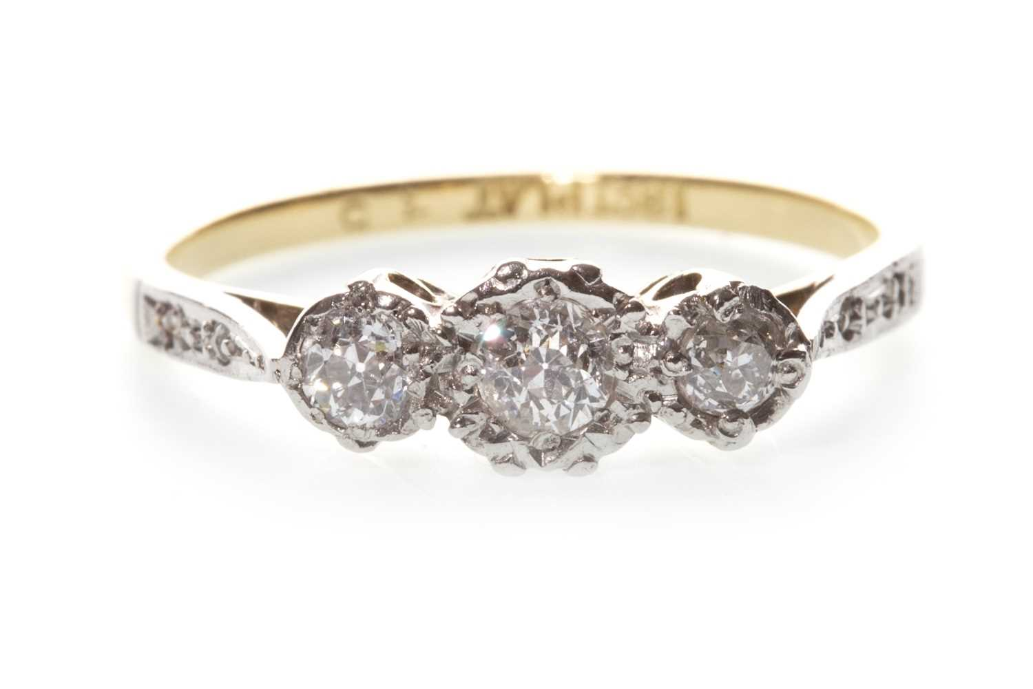 Lot 7-A DIAMOND THREE STONE RING