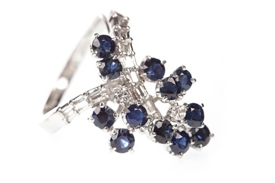 Lot 18-A BLUE GEM SET AND DIAMOND RING