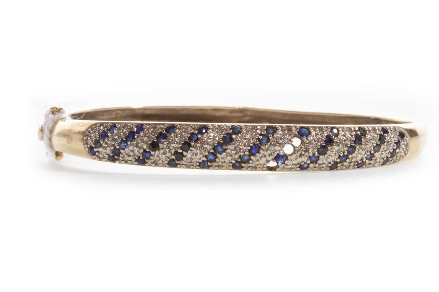Lot 24-A BLUE GEM AND DIAMOND BANGLE