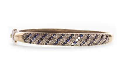 Lot 24-A BLUE GEM AND DIAMOND BANGLE