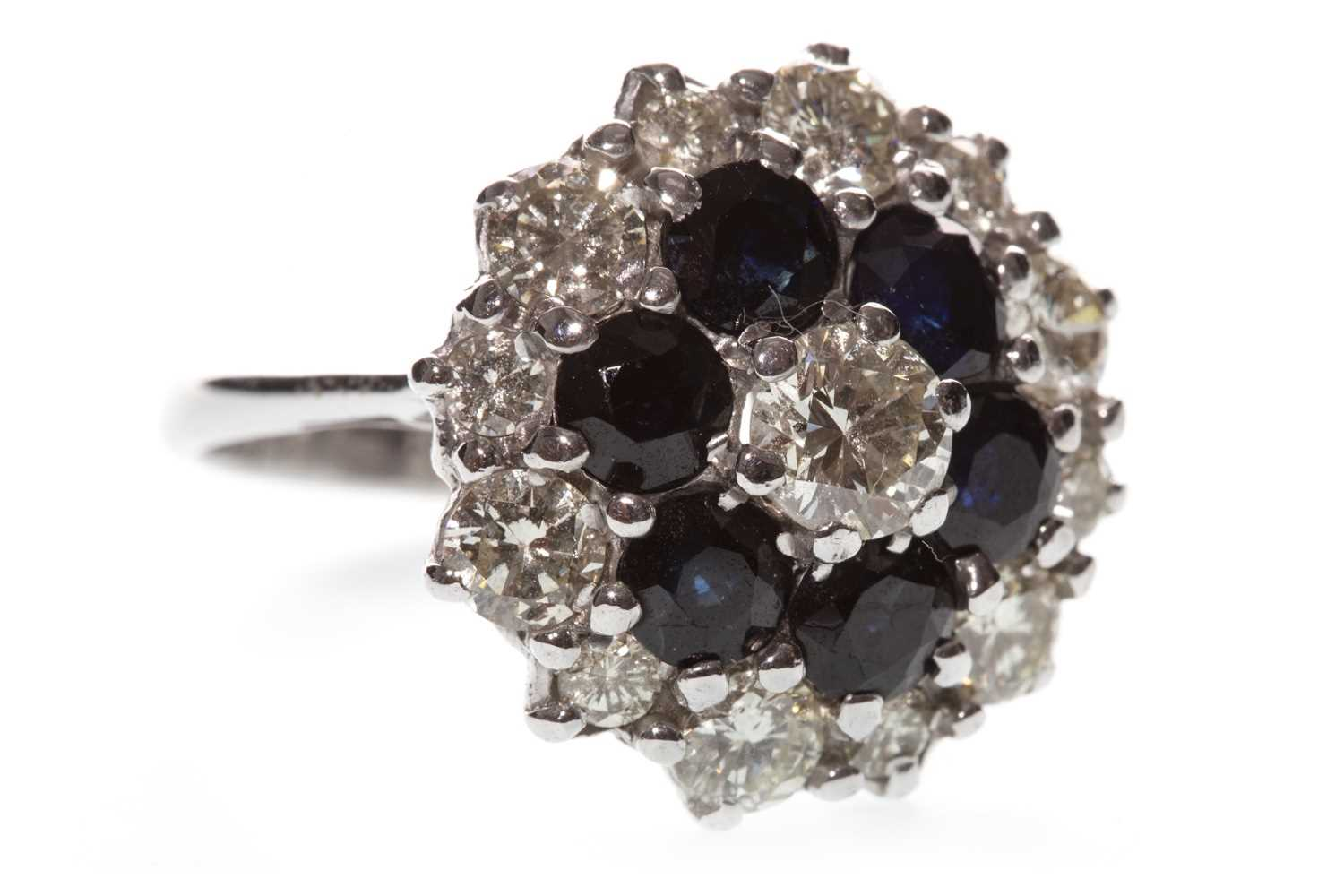 Lot 34-A BLUE GEM AND DIAMOND CLUSTER RING