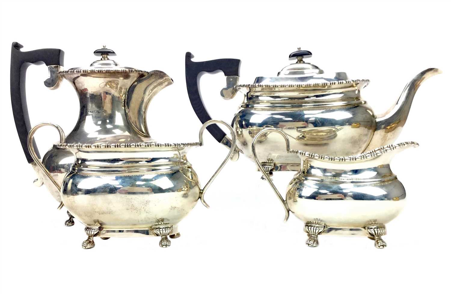 Lot 868 - A SILVER FOUR PIECE TEA AND COFFEE SERVICE