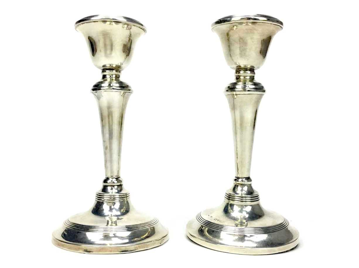 Lot 874 - A PAIR OF GEORGE V SILVER CANDLESTICKS