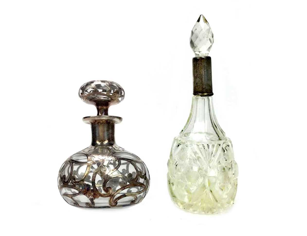 Lot 879 - A LOT OF TWO SILVER OVERLAID PERFUME BOTTLES