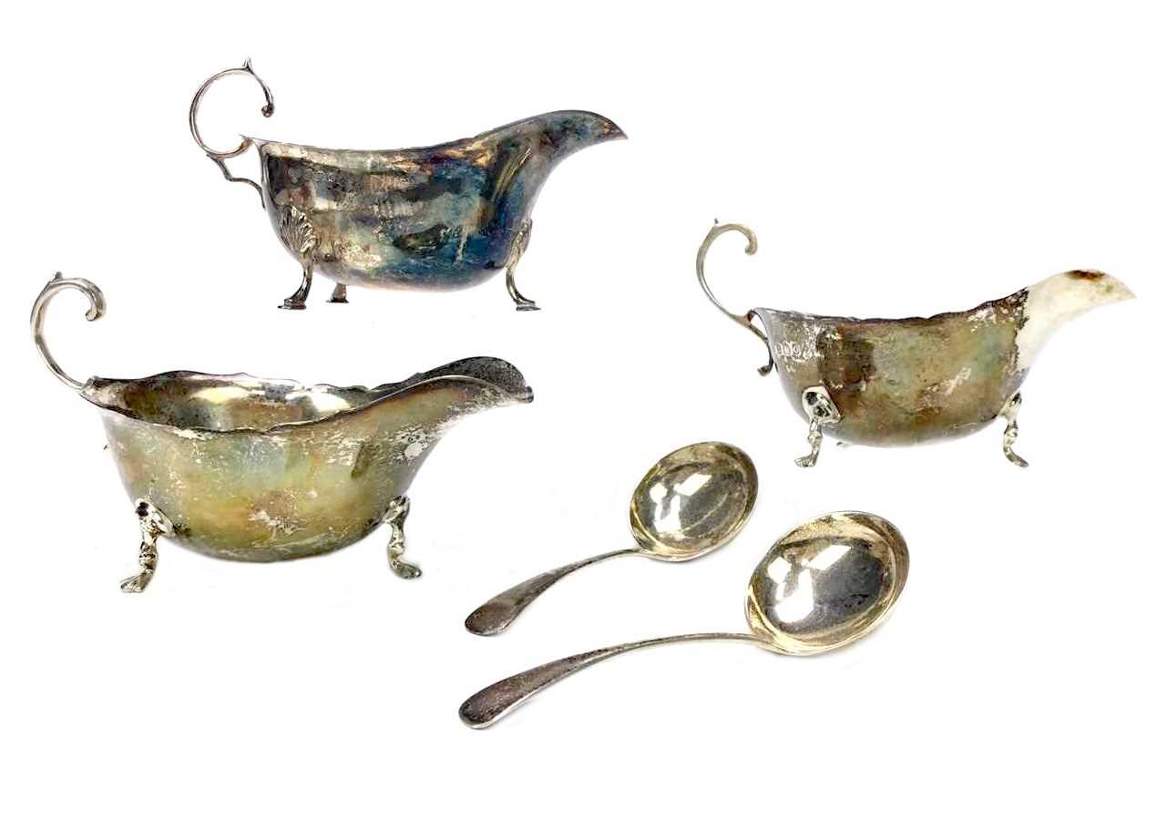 Lot 880 - A LOT OF THREE SILVER SAUCE BOATS AND TWO SAUCE LADLES